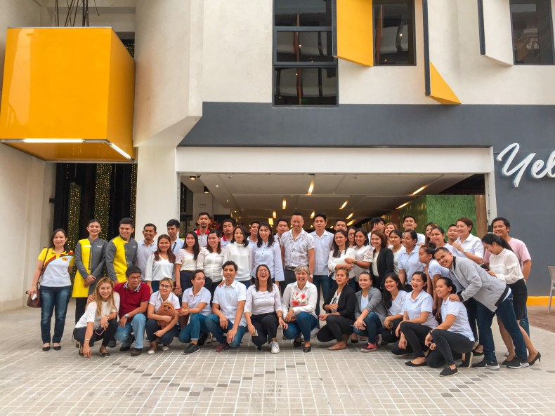 photo outside of yello hotel with its staff