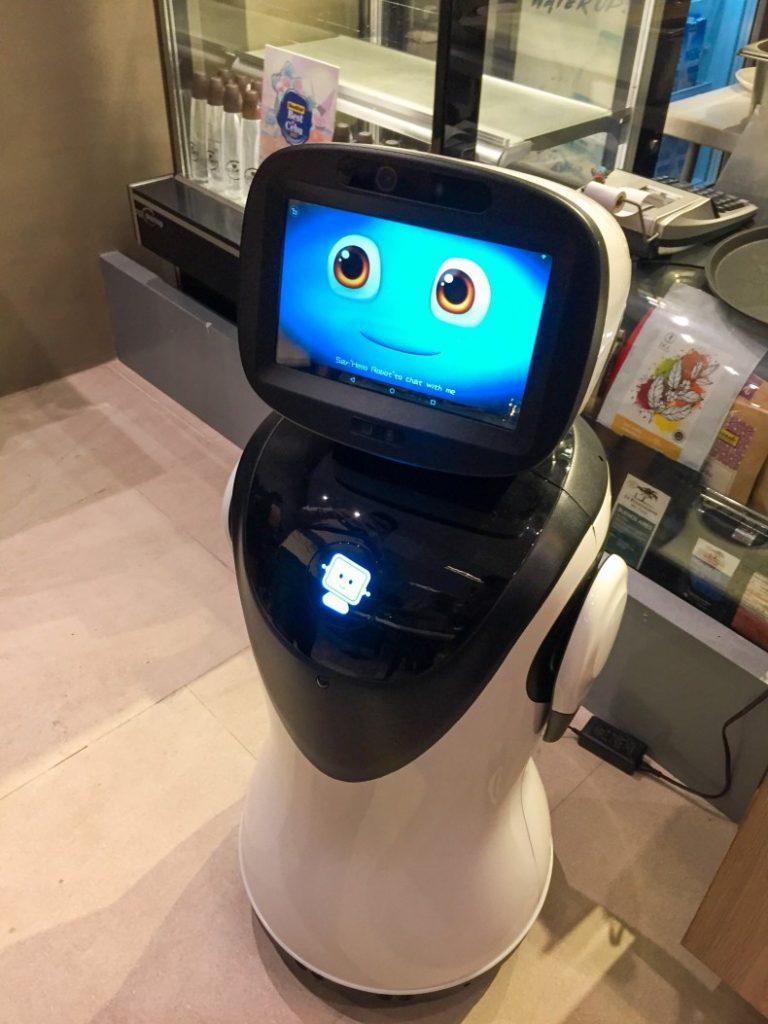photo of yello hotel interactive robot smiling